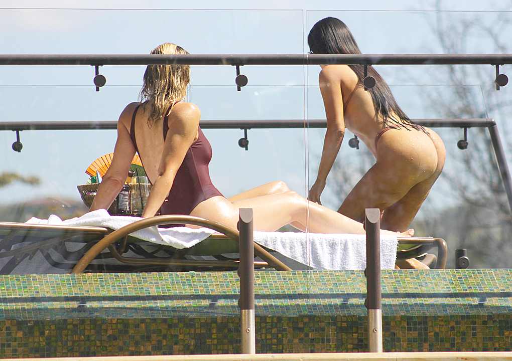 PHOTOS: Khloe Kardashian and Kim relax poolside in Costa Rica