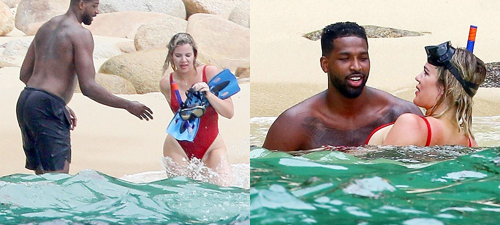 khloe kardashian wearing one piece red swimsuit
